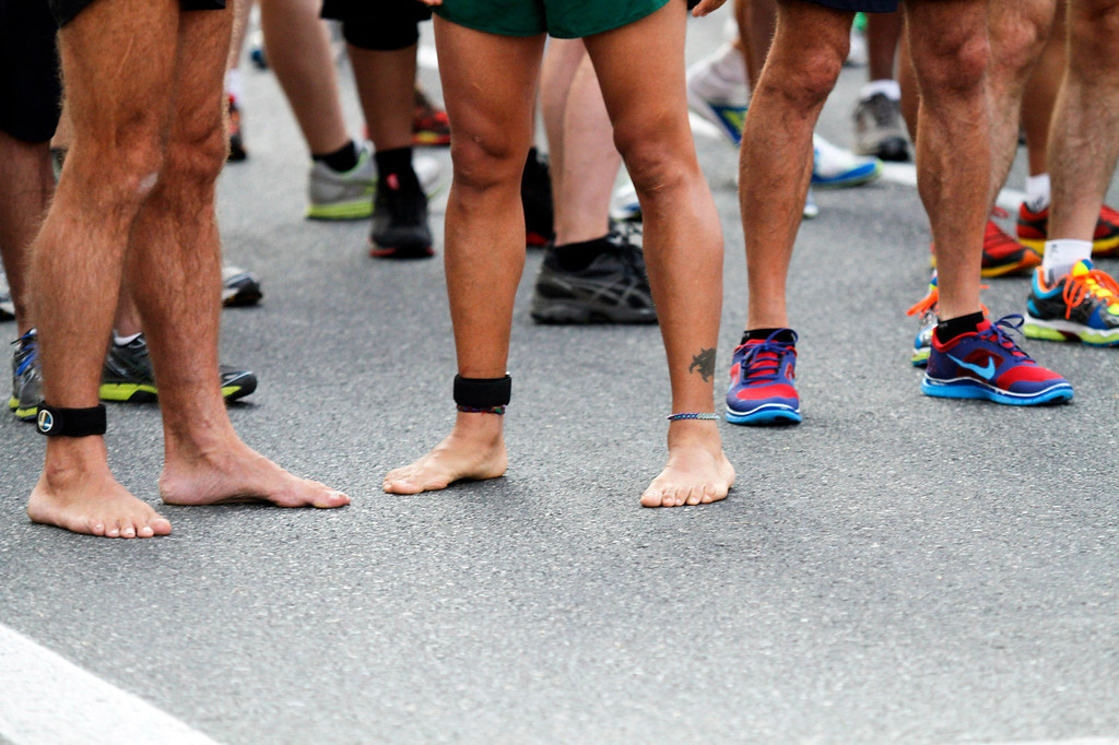 . Some participants choose to run barefooted for the 5th Annual Pasadena Marathon Event, at Pasadena City College, in Pasadena, Sunday, June 30, 2013. (SXCITY/Correspondent Photo by James Carbone)