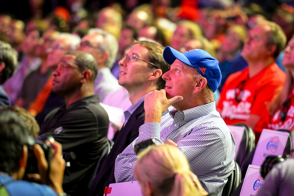 . New Clippers owner Steve Ballmer watches a Clippers highlight reel at Staples Center Monday August 18, 2014.  ( Photo by David Crane/Los Angeles Daily News )
