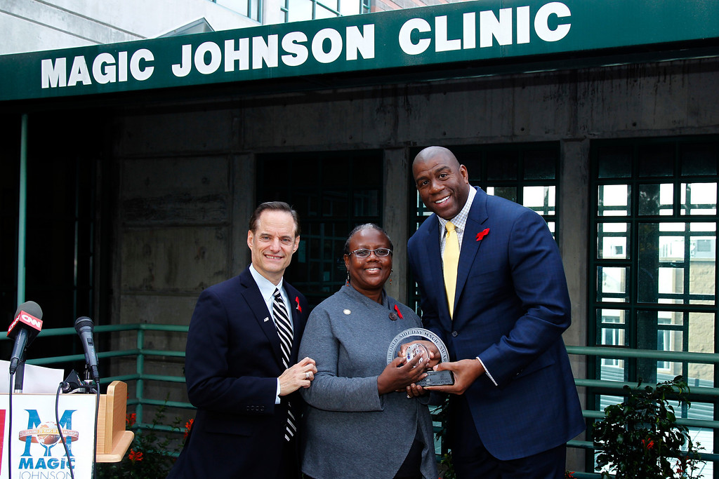 """. In this photo taken by AP Images for AIDS Healthcare Foundation, basketball legend and AIDS advocate Earvin �Magic� Johnson, right, poses for a photo with the recipient of the \""""World AIDS Day Magic Award,\"""" assistant professor, Medical Science Institute, Charles Drew University of Medicine and Science Cynthis Davis, center, and AIDS Healthcare Foundation president Michael Weinstein during a press conference to present the 2nd annual \""""World AIDS Day Magic Award\"""" and kick off the free HIV testing caravan at the AHF Magic Johnson Clinic in Los Angeles Thursday, Dec. 1, 2011. (Joe Kohen/AP Images for AIDS Healthcare Foundation)"""