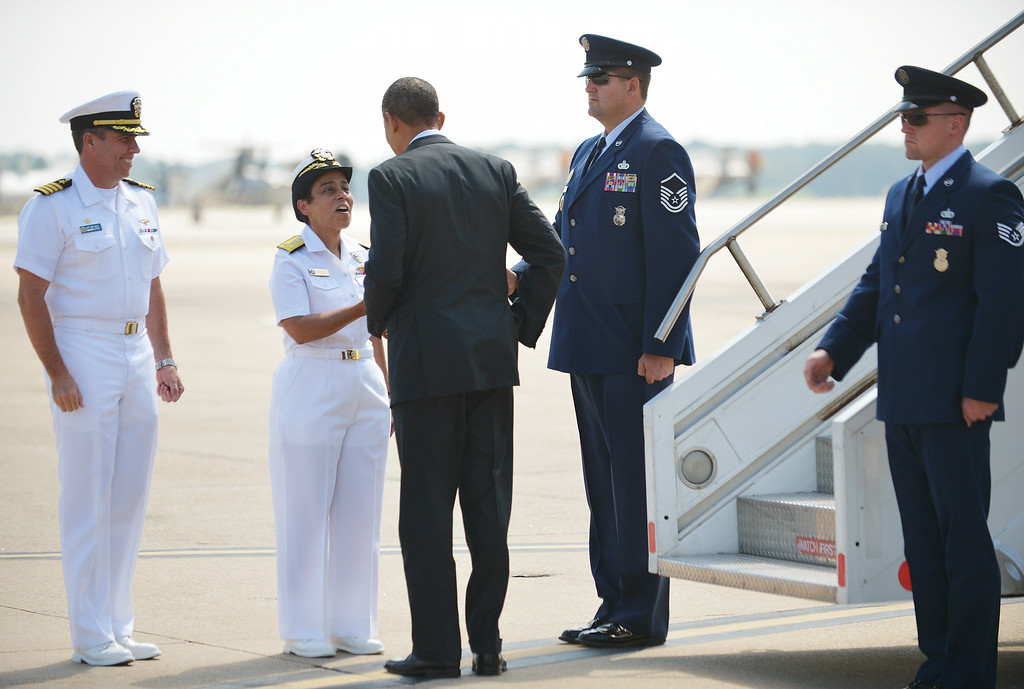 . US President Barack Obama is greeted by Vice Admiral Michelle Howard (2nd-L), Deputy Commander US Fleet Forces Command, and Captain David Culler, Commanding Officer Naval Station Norfolk, upon arrival at Naval Air Station Norfolk September, 4, 2012 in Norfolk, Virginia. Obama was headed to Norfolk, Virginia to attend a campaign rally at the Norfolk University.         (MANDEL NGAN/AFP/GettyImages)