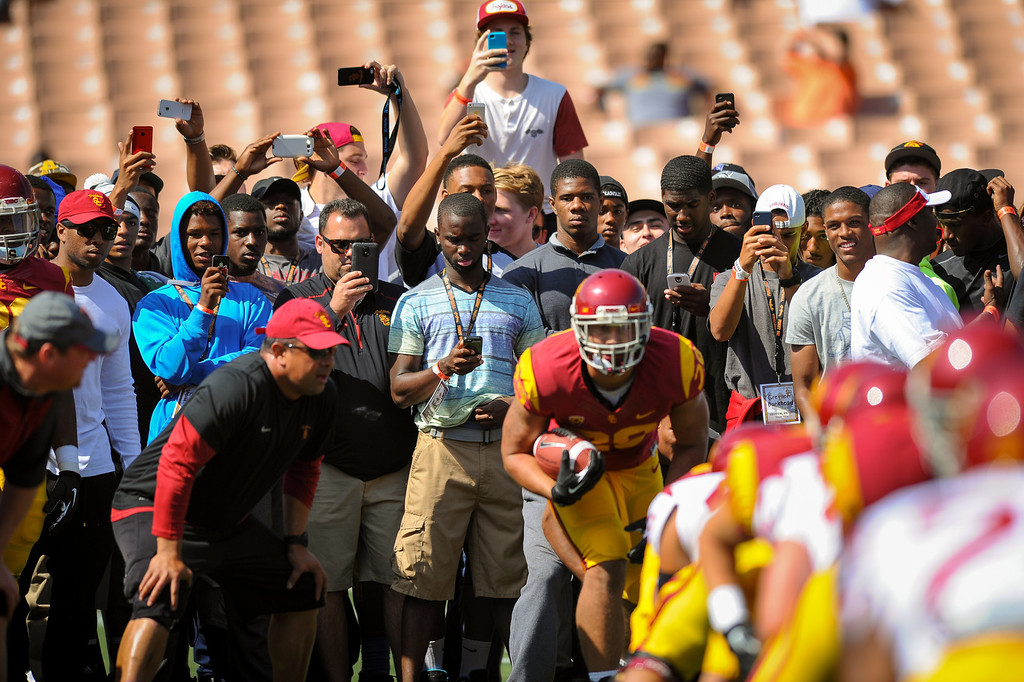 . A crowd gathers as USC RB Ty Isaac gets set to run a drill before the spring game, Saturday, April 19, 2014, at the Coliseum. (Photo by Michael Owen Baker/L.A. Daily News)
