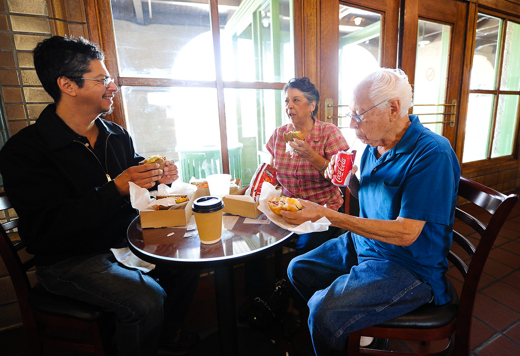 . San Bernardino resident Hank Luna, left, treats his parents Marina and Henry Luna to lunch for the first time at the Iron Horse Cafe inside the Santa Fe Depot in San Bernardino on Wednesday, Sept. 4, 2013. (Photo by Rachel Luna / San Bernardino Sun)