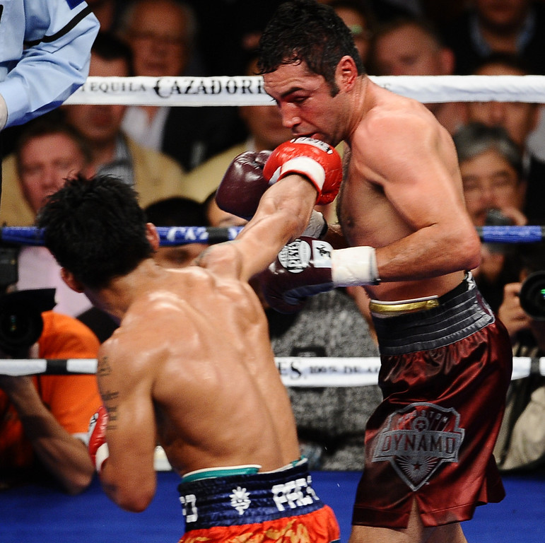 . Manny Pacquiao TKO Oscar De La Hoya after going 8 rounds at the MGM Grand Hotel. Oscar De La Hoya\'s trainer stopped the fight before the start of the ninth round as Manny Pacquiao takes the win for the event . Las Vegas NV. Dec 6,2008. Photo by Gene Blevins/LA Daily News