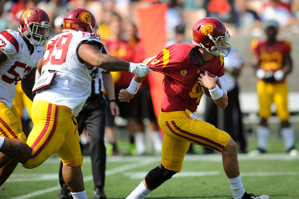 . USC DL Antwaun Woods sacks QB Max Browne during the spring game. (Photo by Michael Owen Baker/L.A. Daily News)
