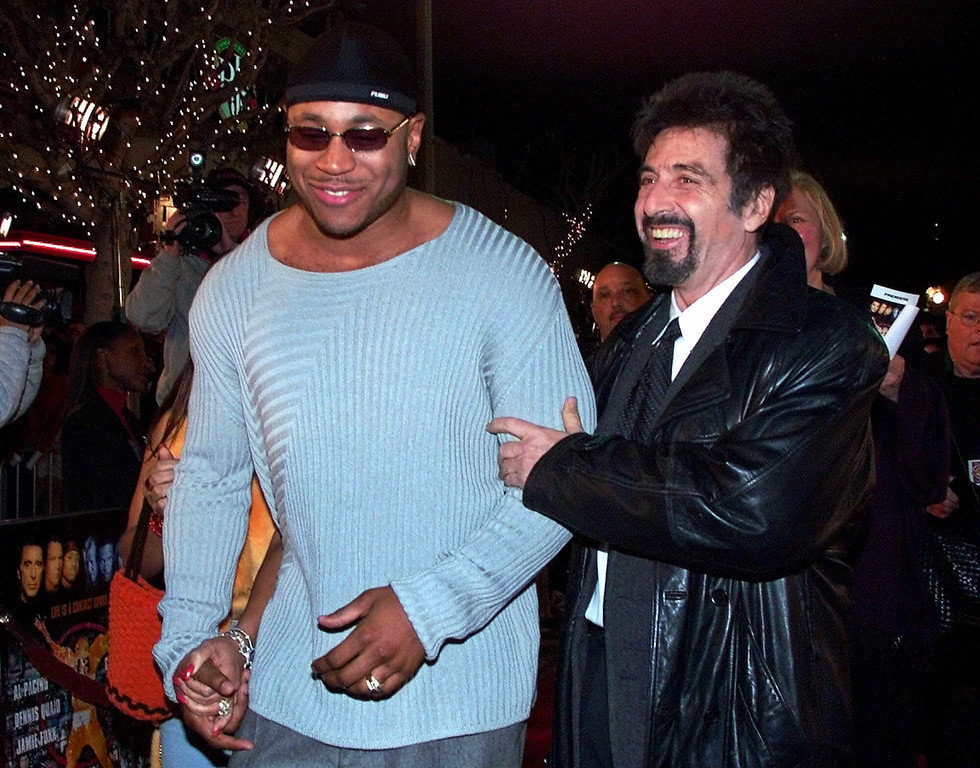 ". LL Cool J, left, and Al Pacino arrive for a screening of their movie ""Any Given Sunday,\"" Thursday, Dec. 16, 1999, in Los Angeles (AP Photo/Mark J. Terrill)"