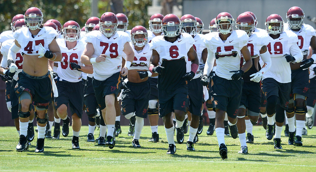 . Defensive players run toward the field for drills. Football practice is in full swing on the Howard Jones Field at USC. Los Angeles, CA. 8/6/2014(Photo by John McCoy Daily News)