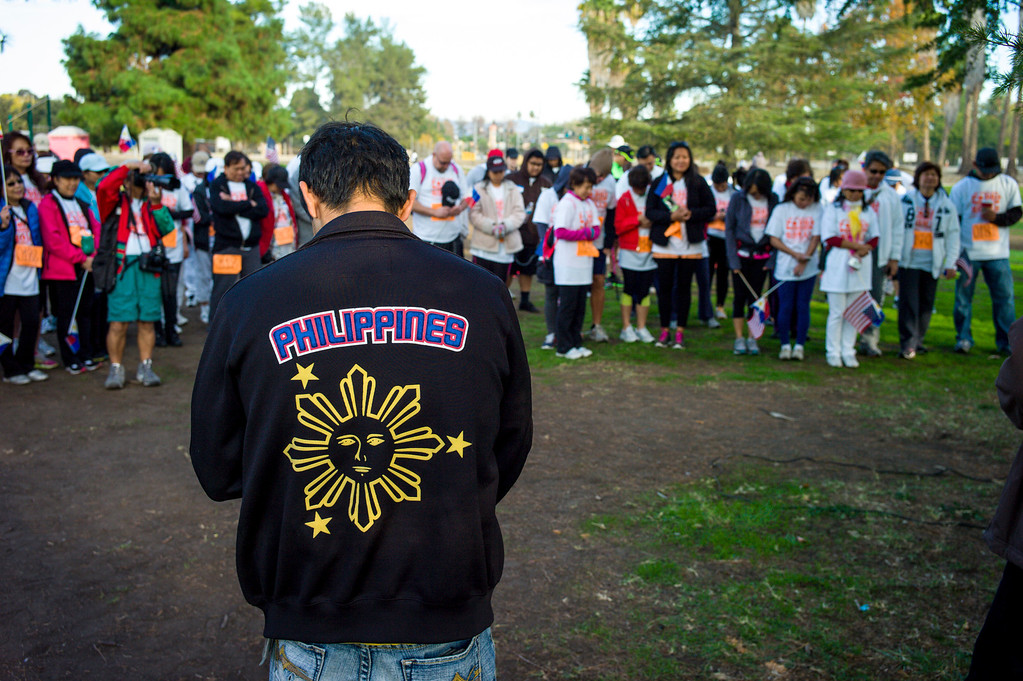 . Walkers gather before heading out on a 5k walk for hurricane disaster relief at Balboa Park in Van Nuys, CA Sunday, November 10, 2013.  The ROMAH Foundation, Inc. in partnership with Philippine Disaster Relief Organization held a walk and fundraiser for disaster relief in the Philippines.   ( Photo by David Crane/Los Angeles Daily News )