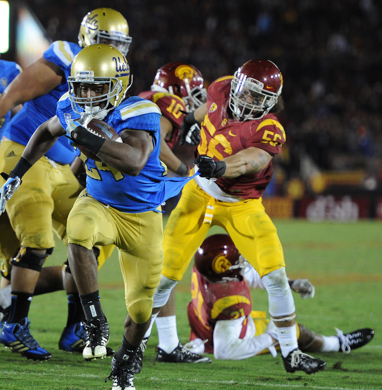 . UCLA Paul Perkins runs into the end zone in the 4th quarter. UCLA defeated USC 35 to 14 in a matchup of cross town rivals at the Los Angeles Memorial Coliseum in Los Angeles, CA.  photo by (John McCoy/Los Angeles Daily News)