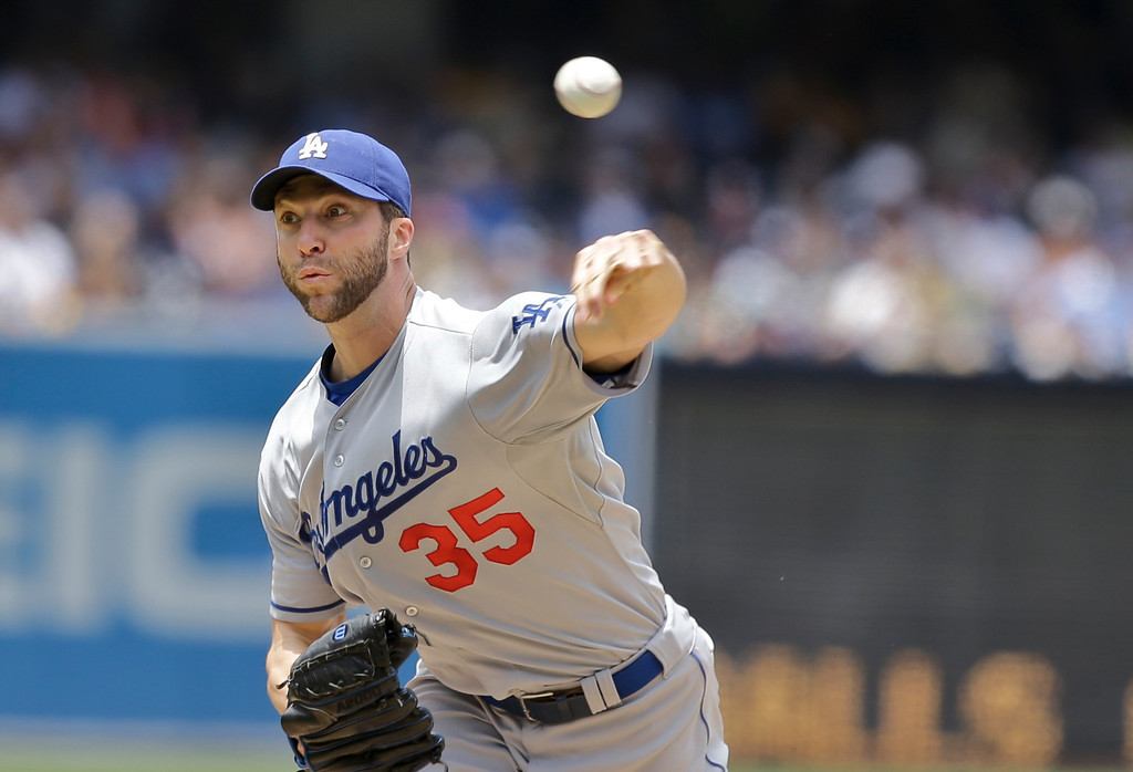 . Los Angeles Dodgers starting pitcher Chris Capuano works against the San Diego Padres in the first inning of a baseball game in San Diego, Sunday, June 23, 2013. (AP Photo/Lenny Ignelzi)