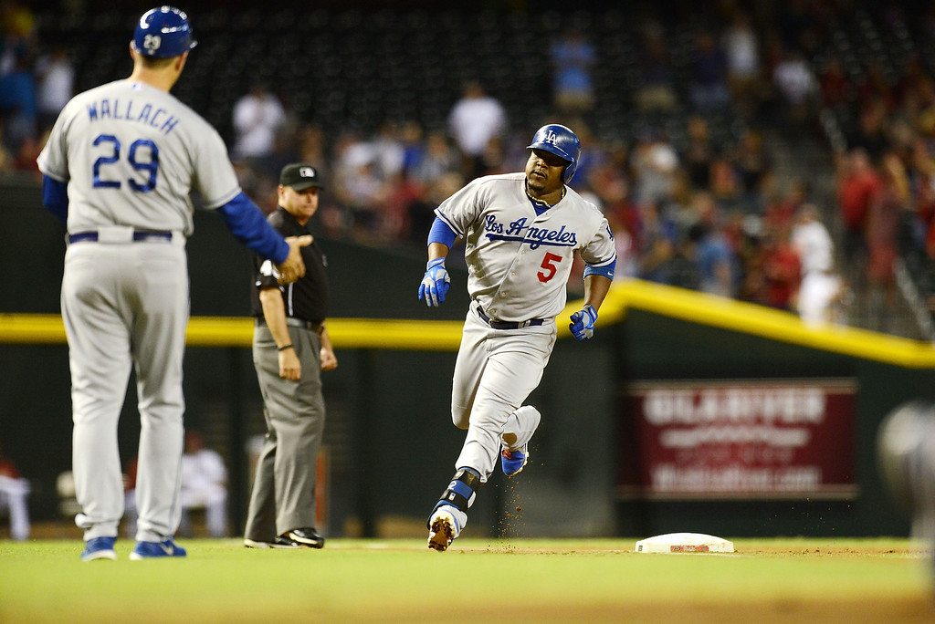 . Juan Uribe #5 of the Los Angeles Dodgers rounds the bases after hitting a home run against the Arizona Diamondbacks at Chase Field on September 17, 2013 in Phoenix, Arizona.  Dodgers won 9-3.  (Photo by Norm Hall/Getty Images)