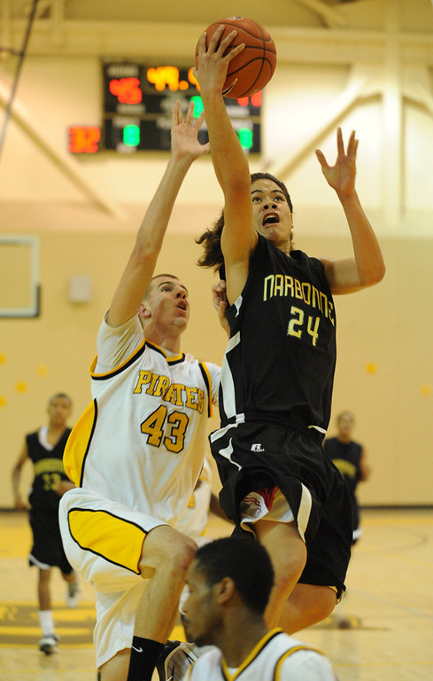 . Narbonne\'s Shailo Leafa (24) takes the ball to the basket over San Pedro\'s Brandon Hrboka (43) in a Marine League basketball game Wednesday night in San Pedro. Narbonne won the game 60-58 on a buzzer beater. January 27, 2010. Photo by Steve McCrank