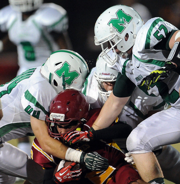 . Arcadia\'s Robbie Hillier (2) is tackled by the Monrovia defense in the first half of a prep football game at Arcadia High School in Arcadia, Calif. on Friday, Sept. 13, 2013.   (Photo by Keith Birmingham/Pasadena Star-News)