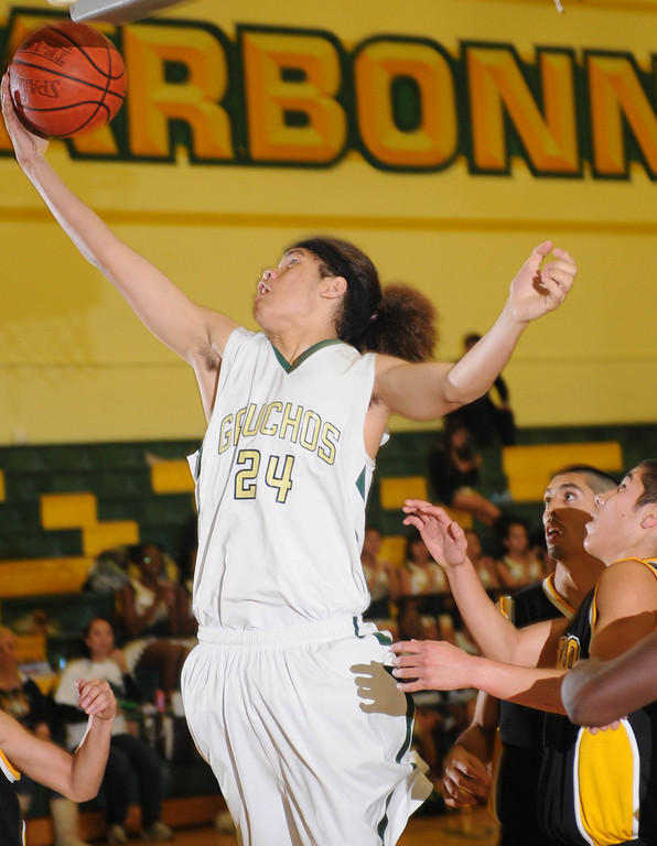 . Narbonne\'s Shailo Leafa (24) pulls down a defensive rebound against San Pedro in a Marine League basketball game Friday evening. Narbonne won the game 47-41 in front of their home crowd. February 12, 2010.  Photo by Steve McCrank