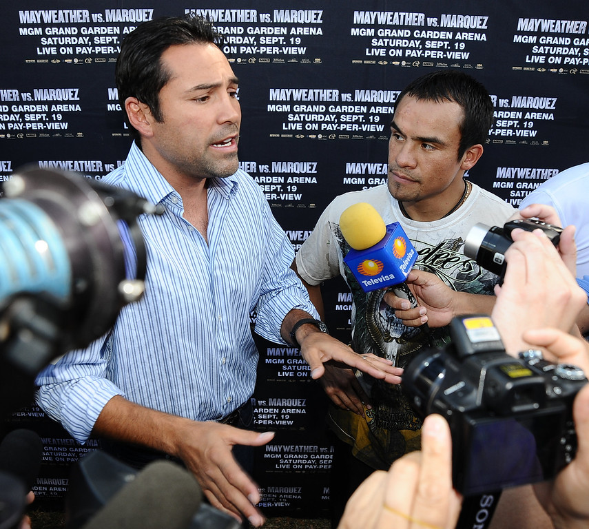 . (L-R) Oscar de la Hoya and Juan Manuel Marquez talk to the media at Olvera Street Plaza about up coming fight next weekend as Juan will fight Mayweather Jr. in Las Vegas. Los Angeles Ca. Sept 13,2009. Photo by Gene Blevins/LA Daily News