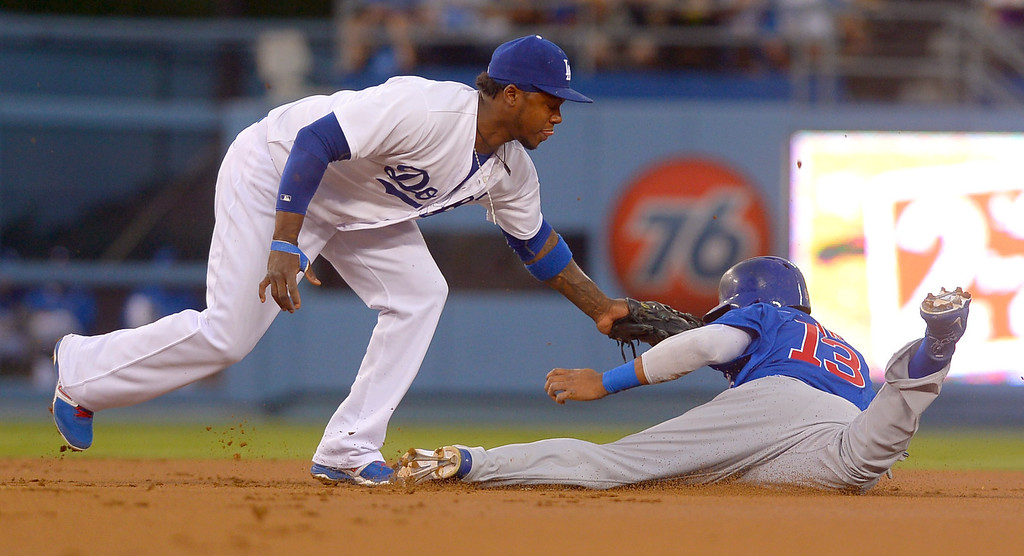 . Cubs baserunner Starlin Castro tries to steal second but is tagged out by Dodgers Hanley Ramirez August 26, 2013 in Los Angeles, CA.(Andy Holzman/Los Angeles Daily News)