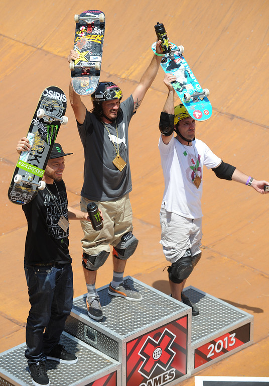 . Celebrating on the medal platform (l-r) Pierre-Luc Gagnon took 2nd, Bucky Lasek 1st, and Andy Macdonald took 3d in the Skateboard Vert Finals at L.A. Live in Los Angeles, CA. 8/3/2013(John McCoy/LA Daily News)