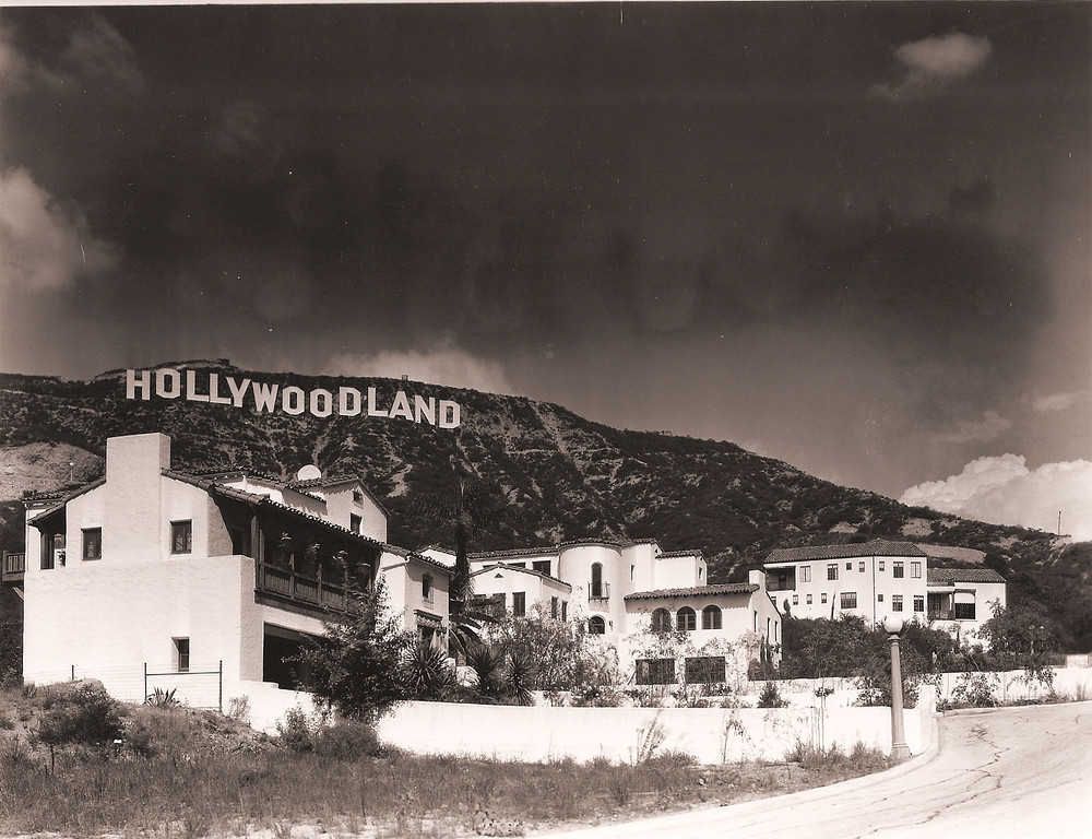 ". In this photo provided by the Bruce Torrence Hollywood Photograph Collection, the famous ""Hollywoodland\"" sign, originally a realtors marketing venture, is visible on Mount Lee looking over Los Angeles, Calif., in this undated photo.  Potential sale of property on Cahuenga Peak near the sign has raised objections from many people and is forcing the city to consider buying the property. (AP Photo/Courtesy of the Bruce Torrence Hollywood Photograph Collection)"