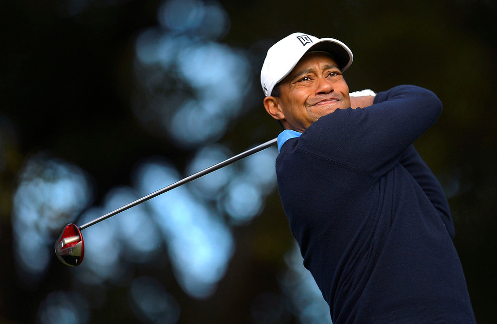 . Tiger Woods tees off on the 6th during the first-round of Tiger Woods\' Northwestern Mutual World Challenge at Sherwood Country Club in Thousand Oaks, CA Thursday December 5, 2013.(Andy Holzman/Los Angeles Daily News)