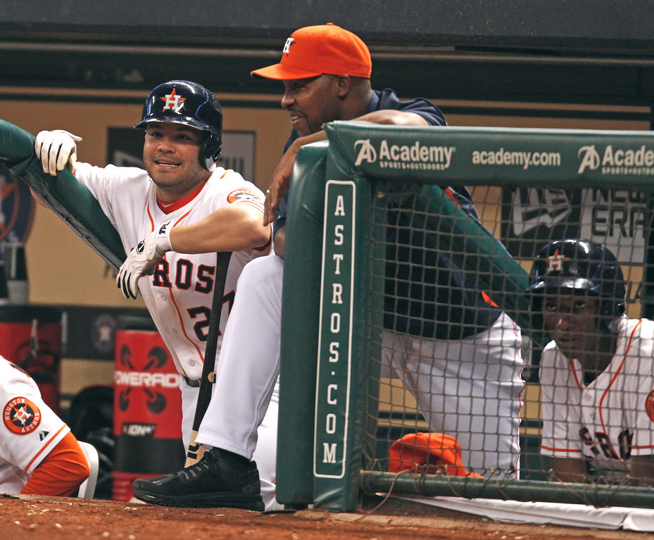 . Houston Astros\' Jose Altuve, left, and manager Bo Porter talk in the dugout in the seventh inning of a baseball game against the Los Angeles Angels on Saturday, Sept. 14, 2013, in Houston. (AP Photo/Eric Christian Smith)