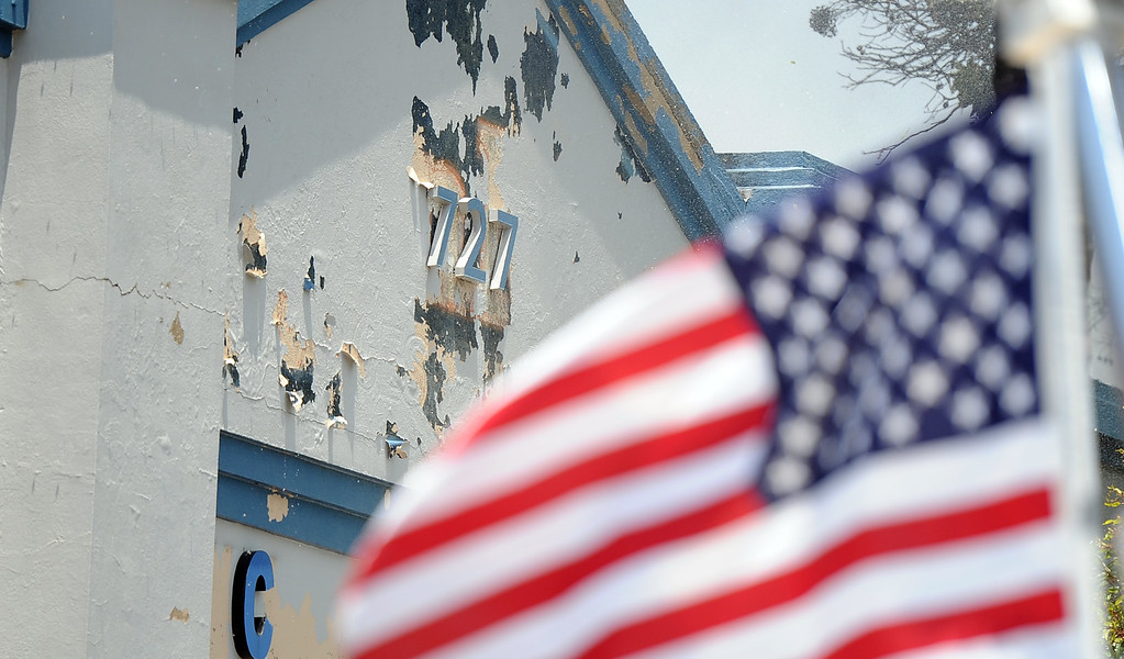 . An American flag waves in the breeze as Los Angeles County firefighters battle 3-alarm fire at an abandoned warehouse near 9th Avenue and Clark Avenue on Tuesday, July 9, 2013 in City of Industry, Calif.  (Keith Birmingham/Pasadena Star-News)