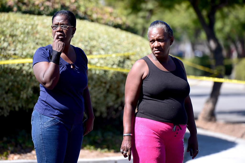 . People watch Pasadena Police investigate an officer involved shooting at Kings Village in Pasadena Friday, October 11, 2013. (Photo by Sarah Reingewirtz/Pasadena-Star News)