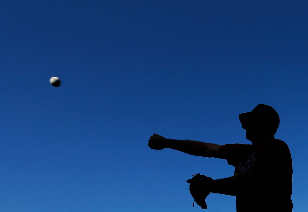 . St. Louis Cardinals hitting coach John Mabry throws before Game 1 of the National League baseball championship series against the Los Angeles Dodgers Friday, Oct. 11, 2013, in St. Louis. (AP Photo/David J. Phillip)