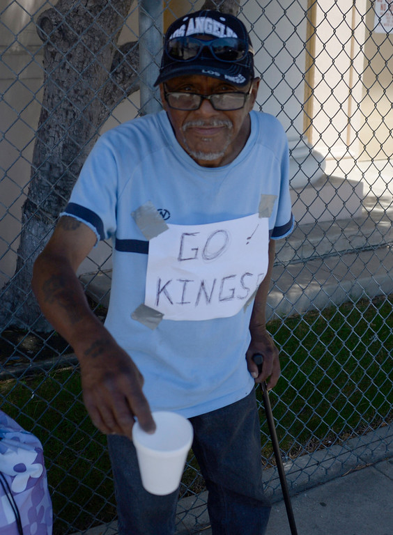 . June 13,2014. Los Angeles. CA. Even the homeless are rooting for the Kings,  as thousands of LA King fans arrive hours early at Staples Center for game 5 of the Stanley Cup Playoffs. Photo by Gene Blevins/LA DailyNews