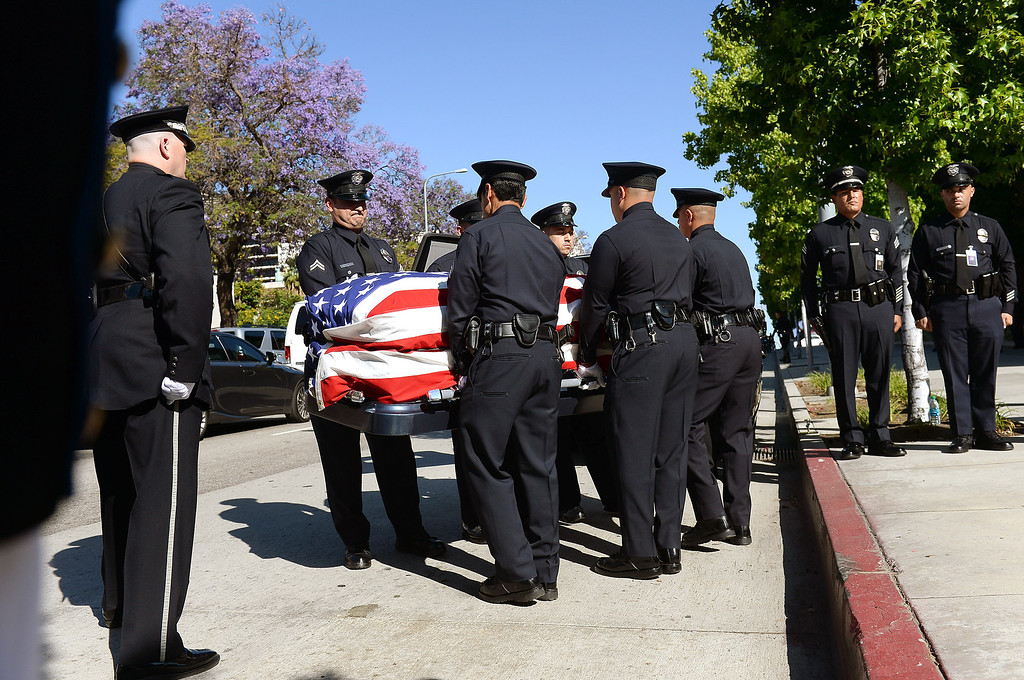 . Pallbearers carry the casket of LAPD Officer Roberto Sanchez during his funeral at the Cathedral of Our Lady of the Angels in Los Angeles, CA May 14, 2014.  Sanchez was killed in a hit-and-run crash involving a SUV driver who is accused of deliberately ramming the officer\'s patrol car in Harbor City.(Andy Holzman/LA Daily News)