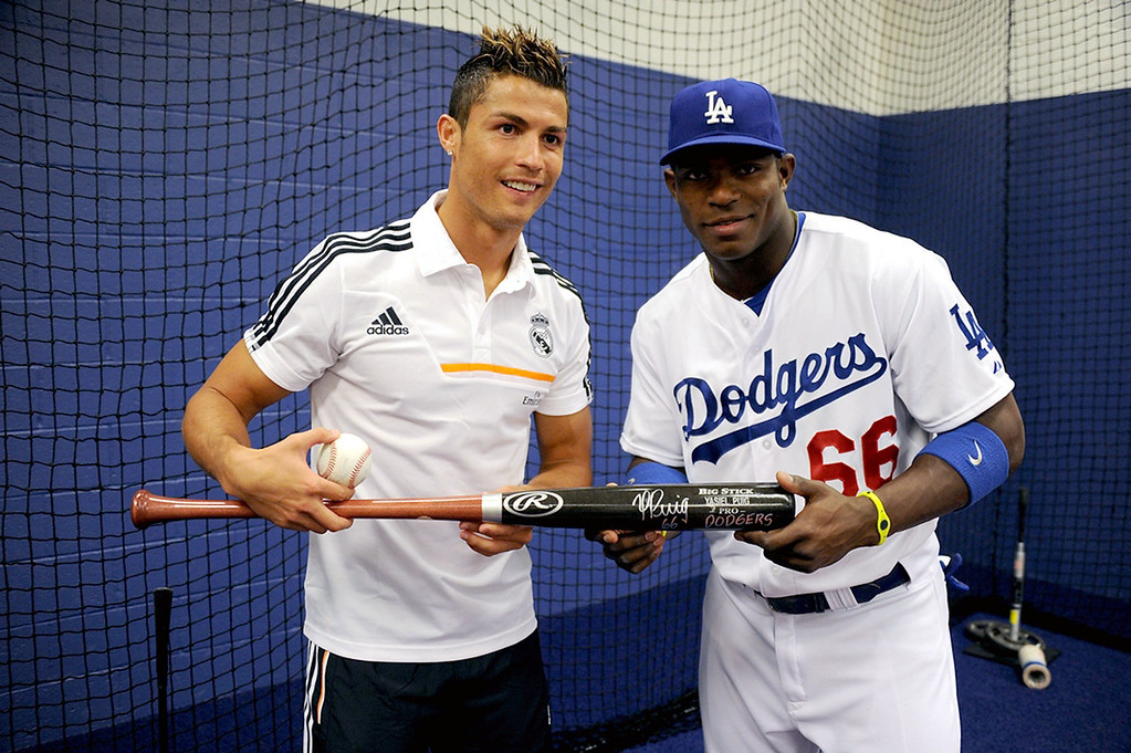 . Real Madrid player Cristiano Ronaldo and Yasiel Puig #66 of the Los Angeles Dodgers attend a game between the Los Angeles Dodgers and the New York Yankees on July 31, 2013 at Dodger Stadium in Los Angeles, Caifornia. (Photo by Jon Soohoo/Los Angeles Dodgers via Getty Images)