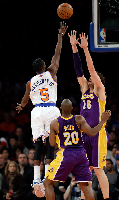 . New York Knicks\' Tim Hardaway Jr. (5) scores over Los Angeles Lakers defenders during the second half of the NBA basketball game at Madison Square Garden, Sunday, Jan. 26, 2014, in New York. The Knicks won 110-103. (AP Photo/Seth Wenig)
