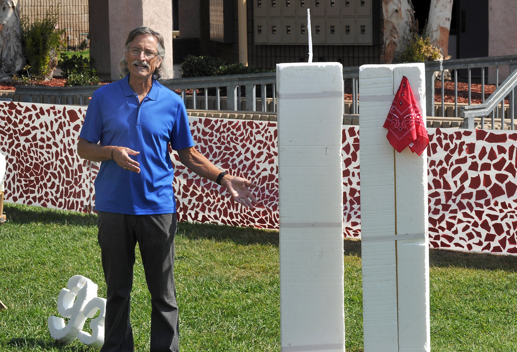 . Art teacher Dave Hamel shows his students the 9/11 display of several white sculptures and a 75-foot banner of torn pieces of paper in the quad at Diamond Bar High School in Diamond Bar, CA on Wednesday September 11, 2013.