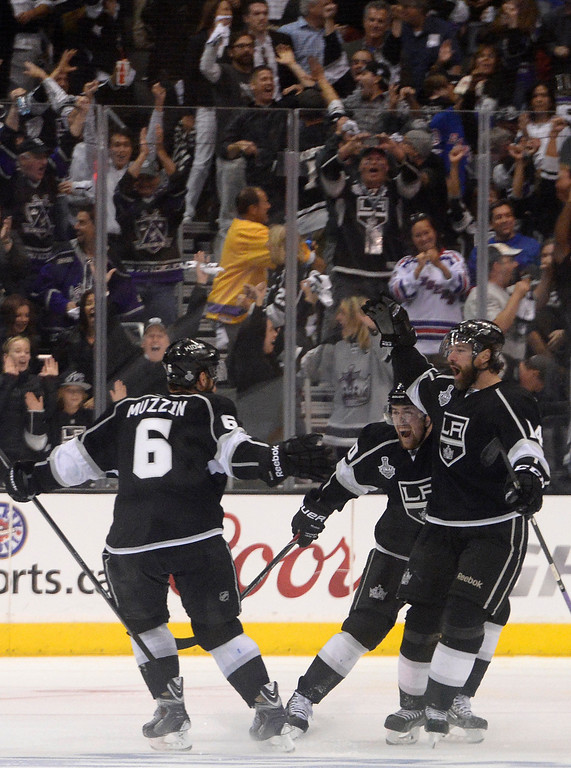 . Kings Jake Muzzin skates over to Justin Williams to congratulate him on the game winning goal. The Los Angeles Kings defeated the New York Rangers in overtime 3-2 in game 1 of the Stanley Cup Finals. Los Angeles, CA. 6/4/2014(Photo by John McCoy / Los Angeles Daily News)
