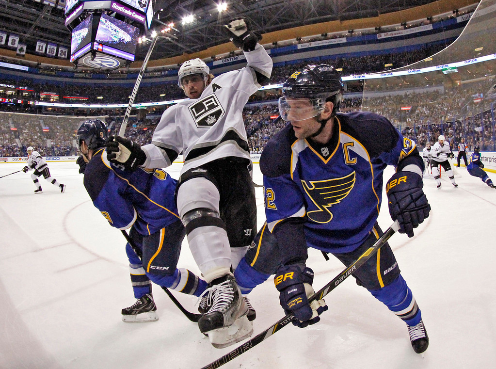 . Los Angeles center Anze Kopitar, center, tangles with Blues center David Backes in second period action during Game 5 of the Western Conference quarterfinals between the St. Louis Blues and the Los Angeles Kings on Wednesday, May 8, 2013, at the Scottrade Center in St. Louis. (AP Photo/St. Louis Post-Dispatch, Chris Lee)