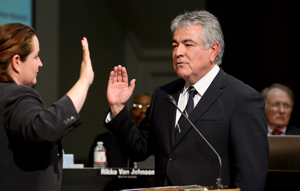 . City Clerk Gigi Hanna swears in City Attorney Gary Saenz at the San Bernardino City Council meeting on Monday, Nov. 18, 2013. The two new city officials were sworn in at the first city council meeting since City Attorney James F. Penman and Councilwoman Wendy McCammack were recalled from those seats. (Photo by Rachel Luna / San Bernardino Sun)