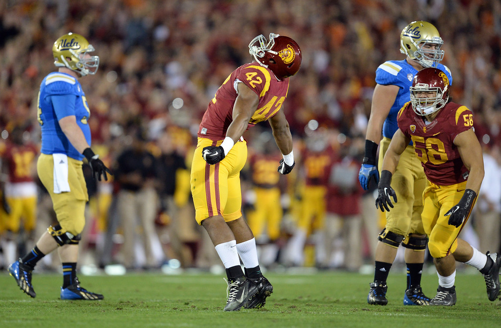 . USC�s Devon Kennard #42 reacts during their game against UCLA at the Los Angeles Memorial Coliseum Saturday, November 30, 2013.  (Photo by Hans Gutknecht/Los Angeles Daily News)