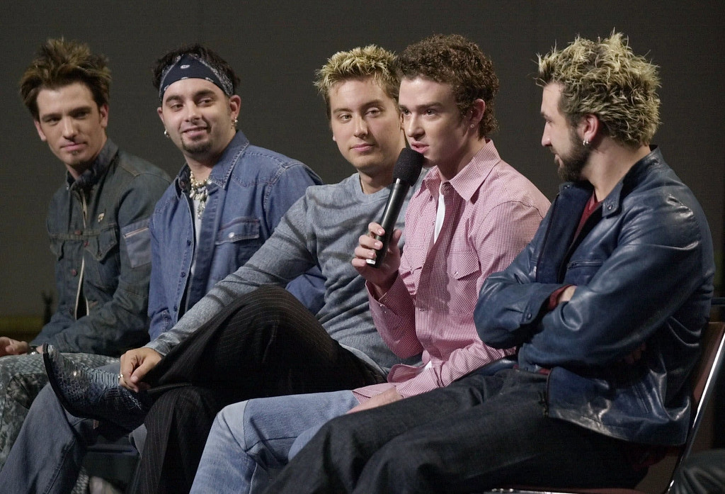 . The musical group \'N Sync, from left, JC Chasez, Chris Kirkpatrick, Lance Bass, Justin Timberlake and Joey Fatone, answer questions during a Super Bowl XXXV Half Time Show news conference Thursday afternoon, Jan. 25, 2001, in Tampa, Fla. (AP Photo/Chris O\'Meara)