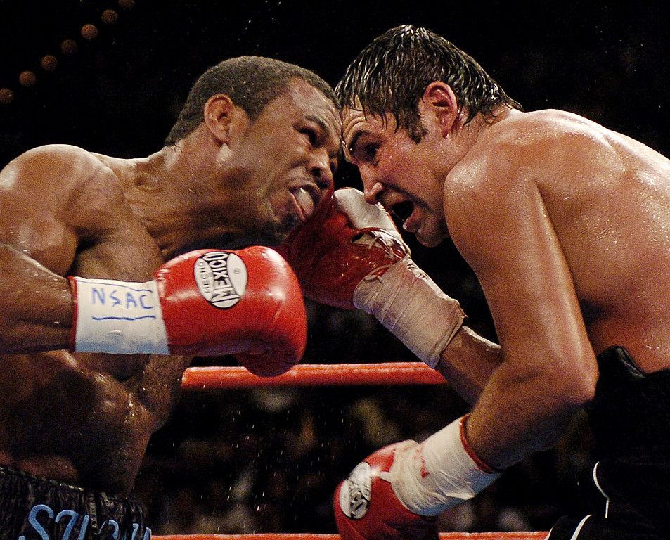 . Oscar De La Hoya, right, and Shane Mosley trade blows in the 12th round of their WBC/WBA super welterweight championship bout in Las Vegas, Saturday, Sept. 13, 2003. Mosley went on to win the bout by unanimous decision. (AP Photo/Mark J. Terrill)