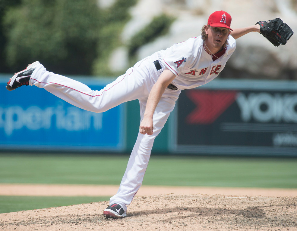 . Angels\' Jered Weaver makes a pitch as they lay the Twins at Angel Stadium in Anaheim on Thursday June 26, 2014. (Photo by Keith Durflinger/Whittier Daily News)