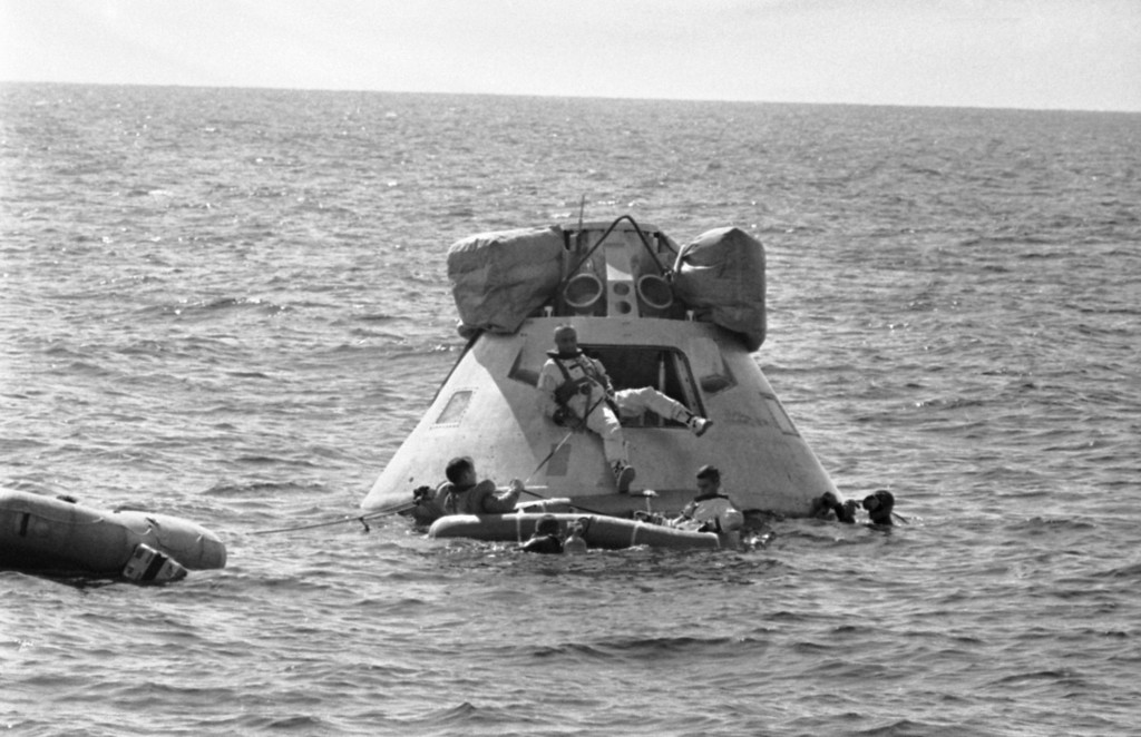 . Astronaut Virgil I. Grissom, center, prepares to join his crew aboard a rubber raft as he leaves an Apollo spacecraft in the water of the Gulf of Mexico on Oct. 27, 1966. The first Apollo crew was training about five miles off the coast of Galveston, Texas on its emergency procedures. Astronaut Edward H. White II is at left in the raft and Astronaut Roger B. Chaffee, is right. (AP Photo/Ed Kolenovsky)