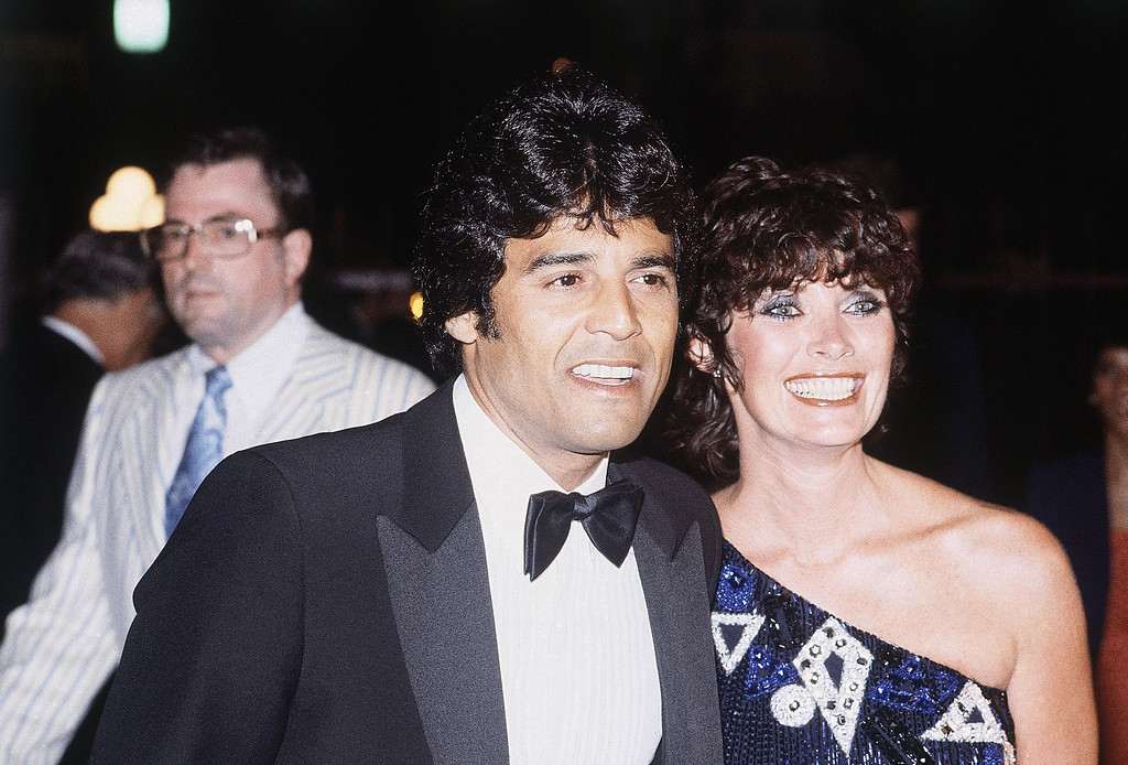 . Actor Erik Estrada with unidentified woman at Universal Amphitheatre in Los Angeles July 30, 1982 while watching Frank Sinatra perform. (AP Photo/Saxon)
