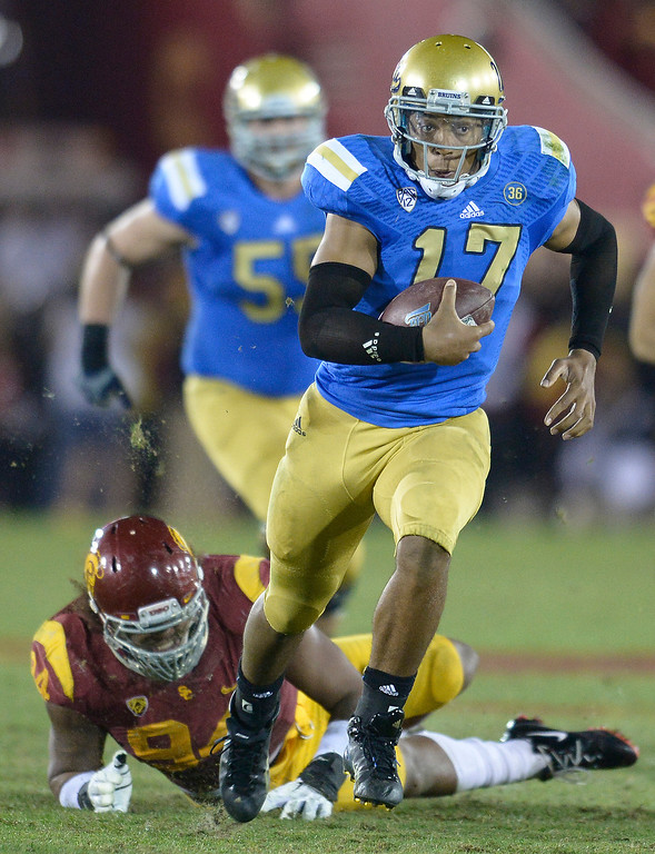 . UCLA QB Brett Hundley gets a run that sets up a Touchdown late in the 4th quarter. UCLA defeated USC 35 to 14 in a matchup of cross town rivals at the Los Angeles Memorial Coliseum in Los Angeles, CA.  photo by (John McCoy/Los Angeles Daily News)