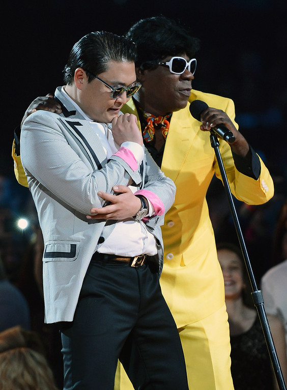 . Rapper Psy (L) and actor/comedian Tracy Morgan joke around at the 2013 Billboard Music Awards at the MGM Grand Garden Arena on May 19, 2013 in Las Vegas, Nevada.  (Photo by Ethan Miller/Getty Images)