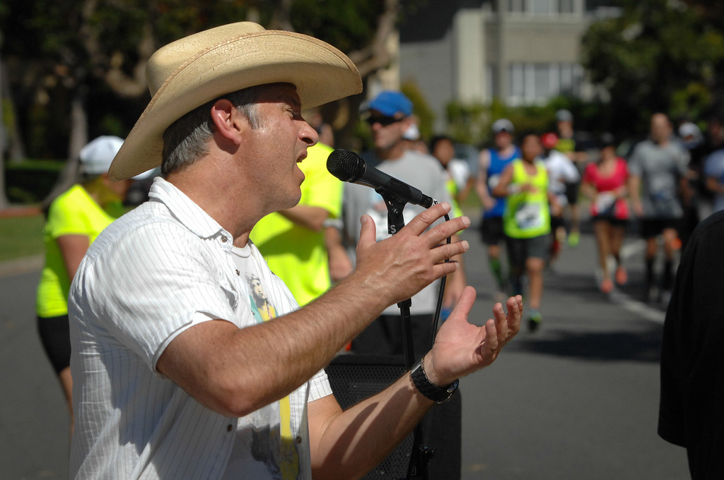 . Todd Leitz sings with his band The Core at the last mile in Santa Monica during the Los Angeles Marathon, Sunday, March 9, 2014. (Photo by Michael Owen Baker/L.A. Daily News)