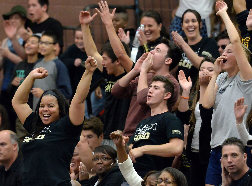 . Bishop Montgomery fans react after scoring against Cantwell in the first half of a CIF Southern California Regional Division IV basketball game at Colony High School in Ontario, Calif., on Saturday, March 22, 2014.  (Keith Birmingham Pasadena Star-News)