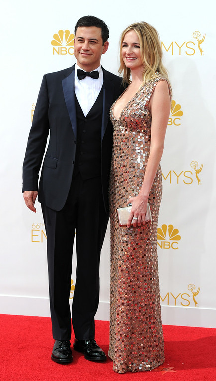 . Jimmy Kimmel (L) and writer/producer Molly McNearney on the red carpet at the 66th Primetime Emmy Awards show at the Nokia Theatre in Los Angeles, California on Monday August 25, 2014. (Photo by John McCoy / Los Angeles Daily News)