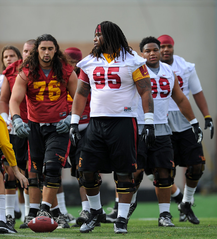 . USC\'s Kenny Bigelow (#95) and linemen line up for drills at spring practice, Tuesday, March 11, 2014, at USC. (Photo by Michael Owen Baker/L.A. Daily News)