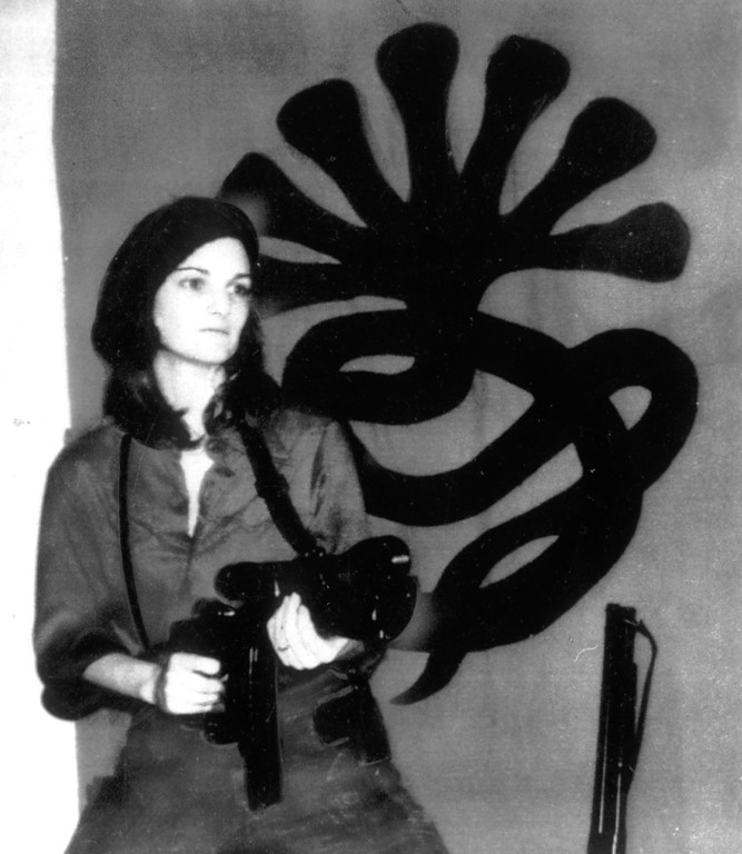 . This is a photo that was received by a San Francisco radio station in April 1974 showing Patty Hearst in front of a Symbionese Liberation Army insignia and holding was was described as an automatic weapon.   (Los Angeles Daily News file photo)