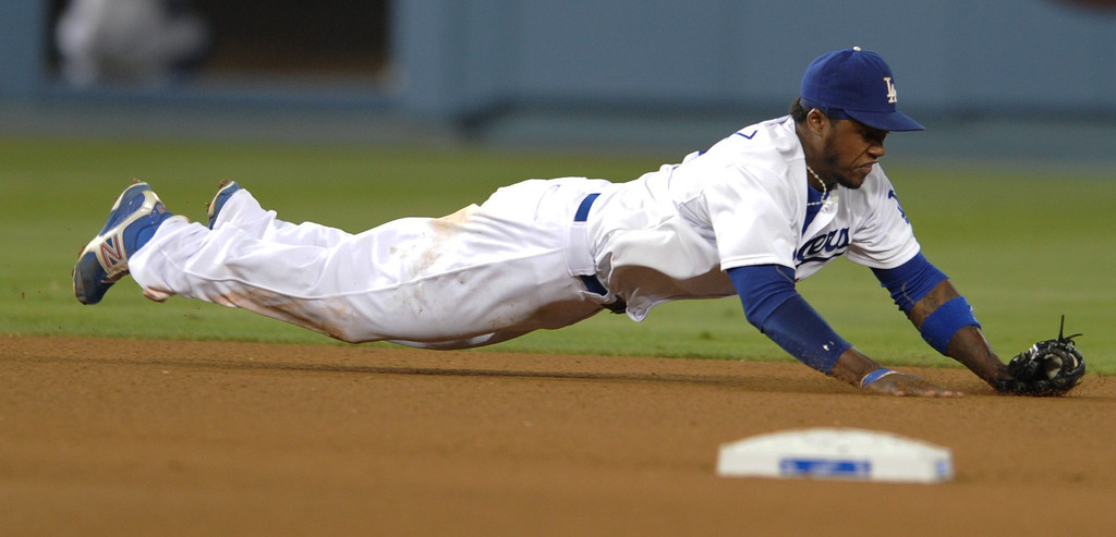 . Dodgers Hanley Ramirez dives for the ball. The Dodgers defeated  the NY Yankees 3-2 in a game at Dodger Stadium in Los Angeles, CA. 7/30/2013(John McCoy/LA Daily News)