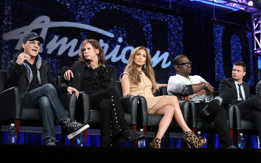 . PASADENA, CA - JANUARY 11:  (L-R) Producer Jimmy Iovine, musicians Steven Tyler, Jennifer Lopez, producer Randy Jackson and host Ryan Seacrest speak onstage during the \'American Idol\' panel at the FOX Broadcasting Company portion of the 2011 Winter TCA press tour held at the Langham Hotel  on January 11, 2011 in Pasadena, California.  (Photo by Frederick M. Brown/Getty Images)