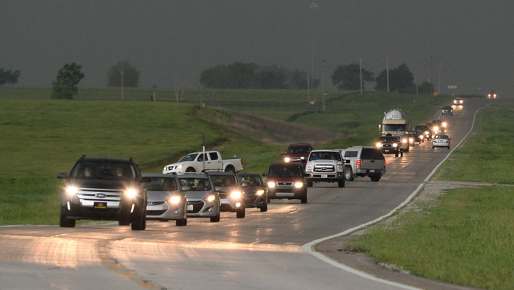 . Storm chasers race to get ahead of a tornadic thunder storm in Clearwater  Sunday May 19th in Kansas.  Several tornadoes that touched down in Oklahoma and Kansas and Iowa were part of a massive, northeastward-moving storm system that stretched from Texas to Minnesota. At least four separate tornadoes touched down in central Oklahoma late Sunday afternoon, including the one near the town of Shawnee were one person was killed 35 miles southeast of Oklahoma City. May 19.2013. South Haven Kansas. Photo by Gene Blevins/LA Daily News